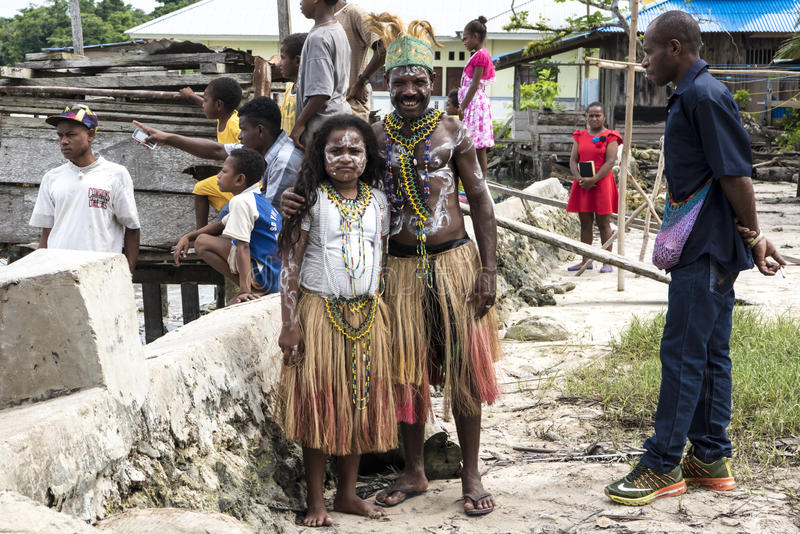Chieftan and daughter Papua, Indonesia royalty free stock images