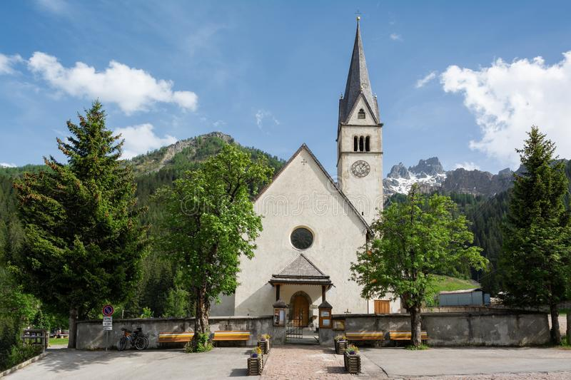 Catholic church of Saints Peter and Paul in Arabba, Trentino, Italy stock images