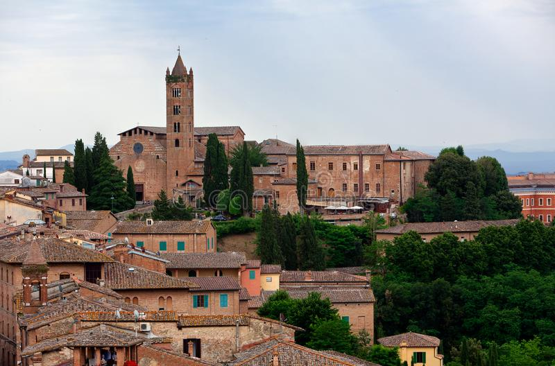 Chiesa San Clemente in Santa Maria dei Servi church landscape City, Siena, Tuscany, Italy. Landscape of the city of Siena with the Chiesa San Clemente in Santa royalty free stock photography