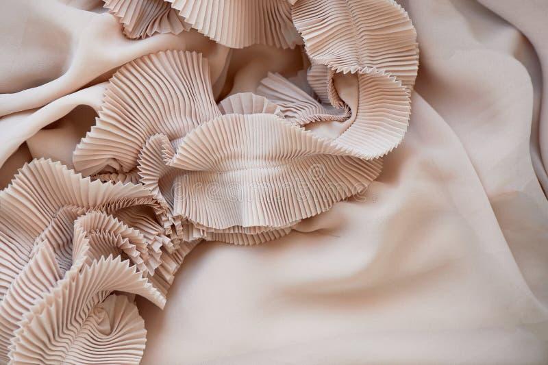 Chiffon ripple cream-colored, powdery shade.The texture is close. Chiffon ripple cream-colored, powdery shade. The texture is close royalty free stock image