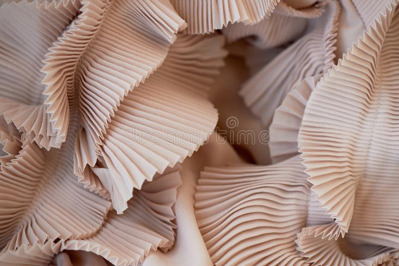 Chiffon ripple cream-colored, powdery shade.The texture is close. Chiffon ripple cream-colored, powdery shade. The texture is close stock photography