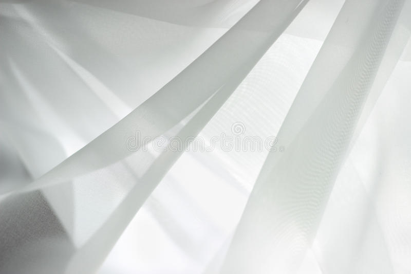 Chiffon textile texture. White and grey colors stock photography