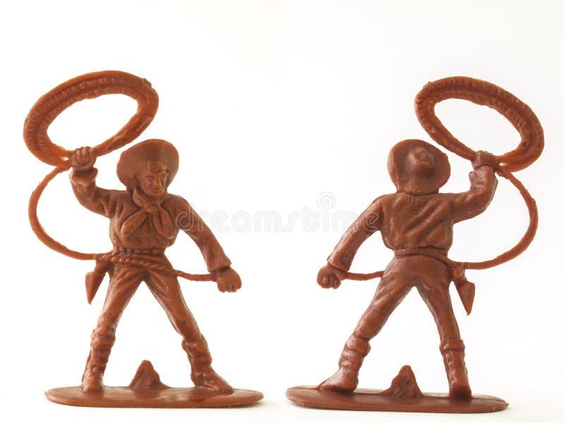Chiffre de cowboy jouet de modèle/blanc d'isolement image libre de droits