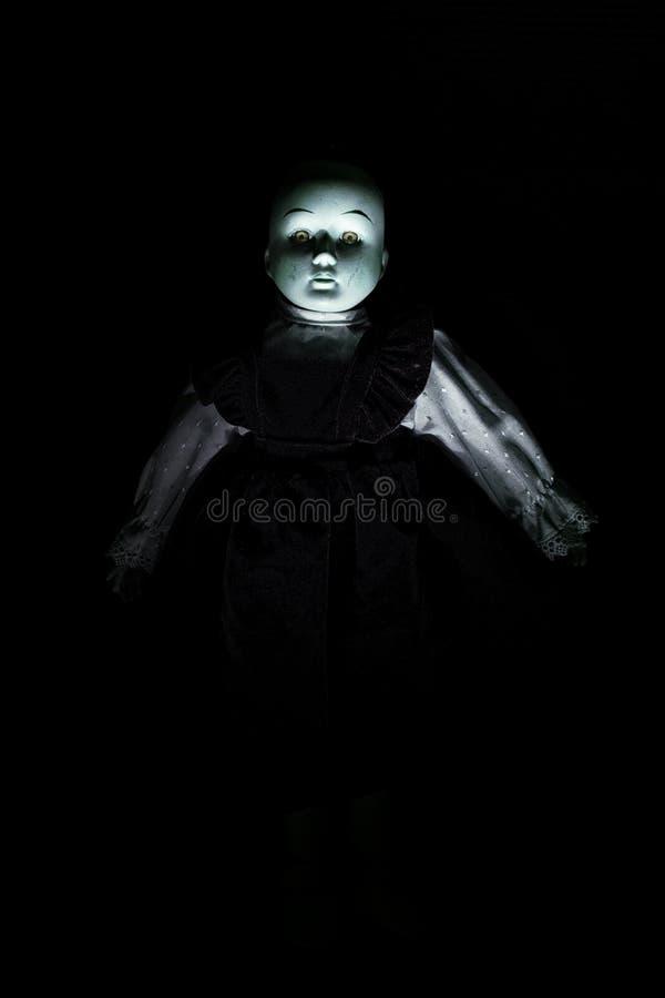 Chiffre de la poupée de l'enfant de hantise photographie stock libre de droits