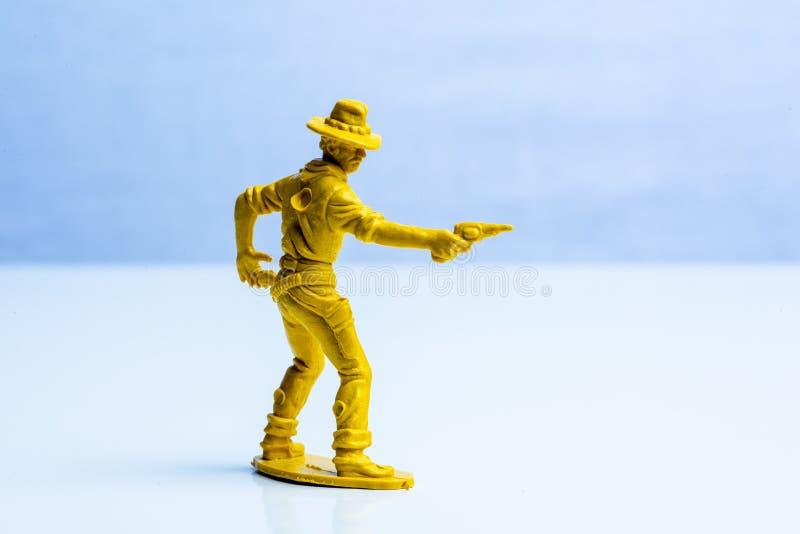 Chiffre en plastique de jouet de cowboy jaune images libres de droits