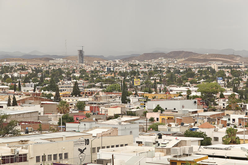 Chihuahua Mexico elevated view of city. Elevated view of Chihuahua, Mexico with mountains in background and tall building being built royalty free stock photography