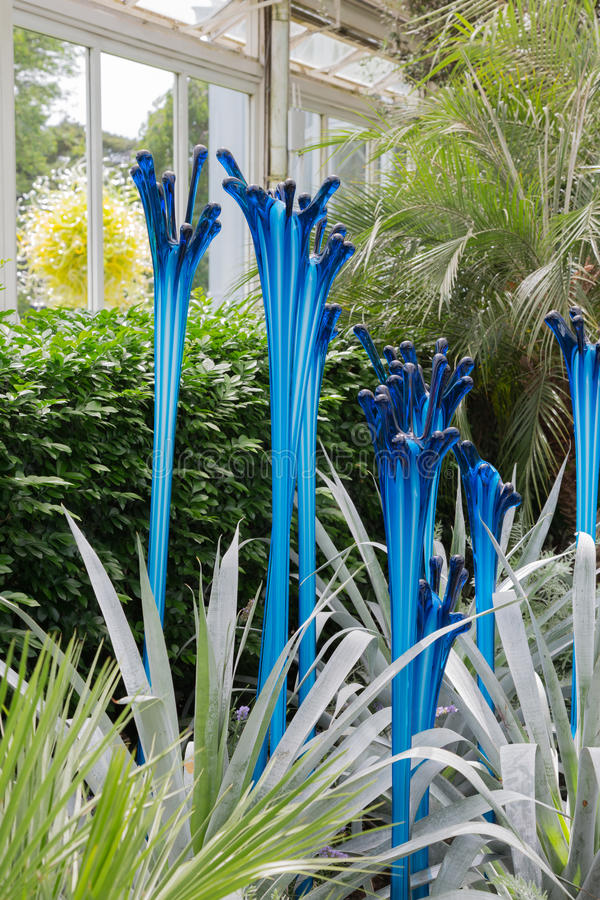 Chihuly Exhibit. BRONX, NY, USA - JUNE 9, 2017: NY BOTANICAL GARDEN. Dale Chihuly`s art exhibition displayed at NYBG. Shown here is Glasshouse Fiori, placed stock images