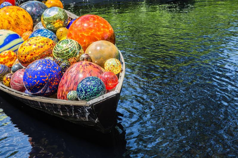 Chihuly Exhibit. BRONX, NY, USA - JUNE 9, 2017: NY BOTANICAL GARDEN. Dale Chihuly`s art exhibition displayed at NYBG. Shown here is his boat installation royalty free stock photography