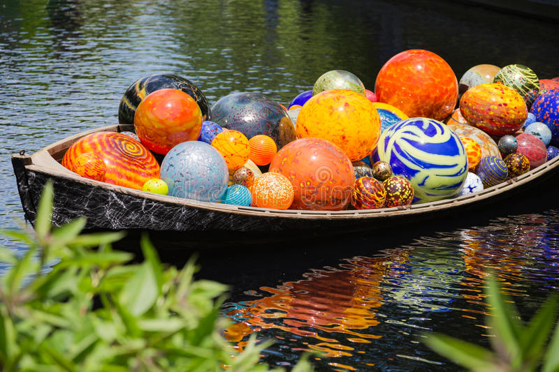 Chihuly Exhibit. BRONX, NY, USA - JUNE 9, 2017: NY BOTANICAL GARDEN. Dale Chihuly`s art exhibition displayed at NYBG. Shown here is his boat installation stock images