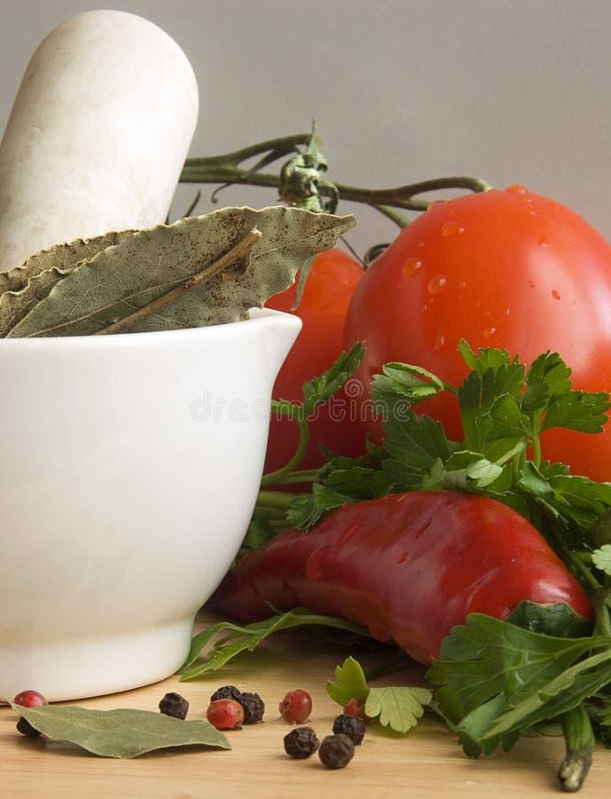 ChiIli, tomates y especias III imagenes de archivo
