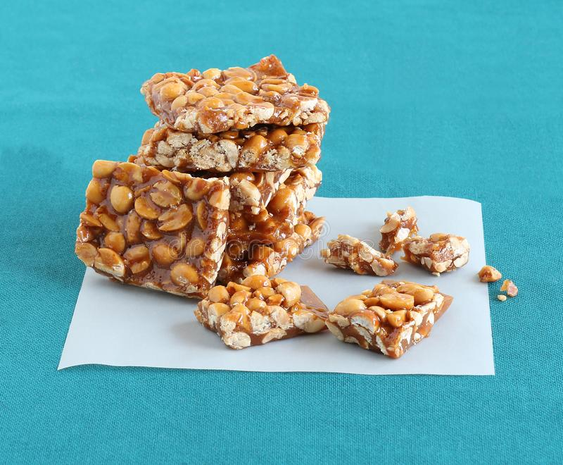 Chikki Indian Sweet on a Parchmen Paper royalty free stock photo
