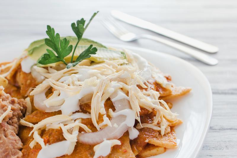 Chilaquiles rojos with chicken and avocado mexican food mexico breakfast stock image