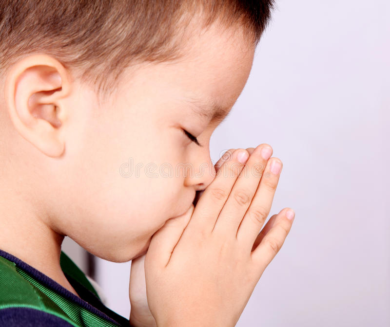 Child. Pray over white background. Beauty image