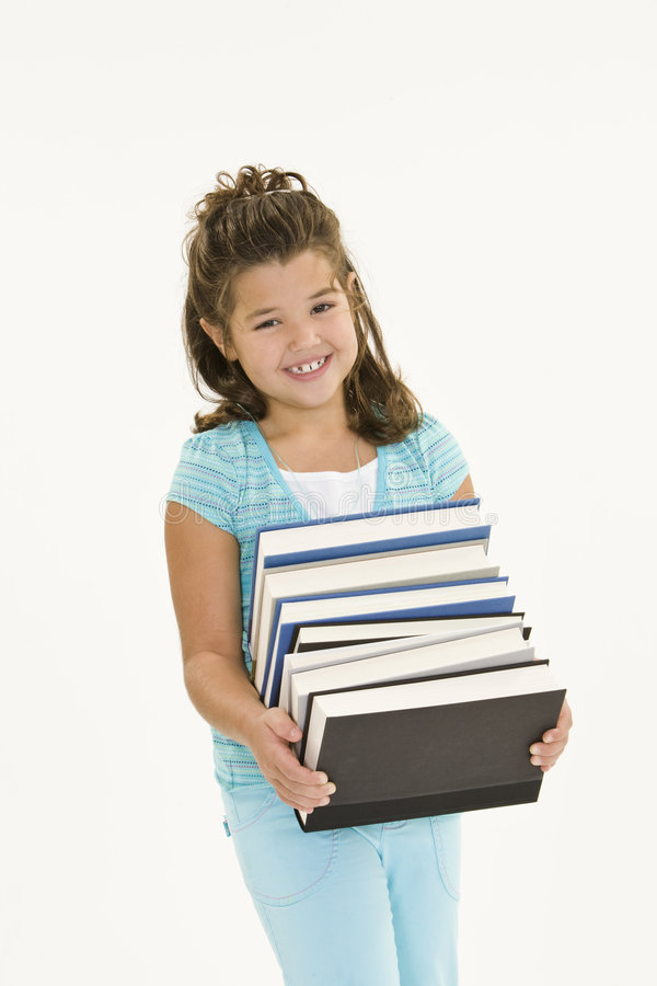 Child. Carrying a load of school books on white background stock image