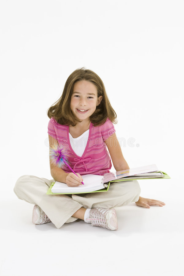Child. Working on homework on white background royalty free stock images