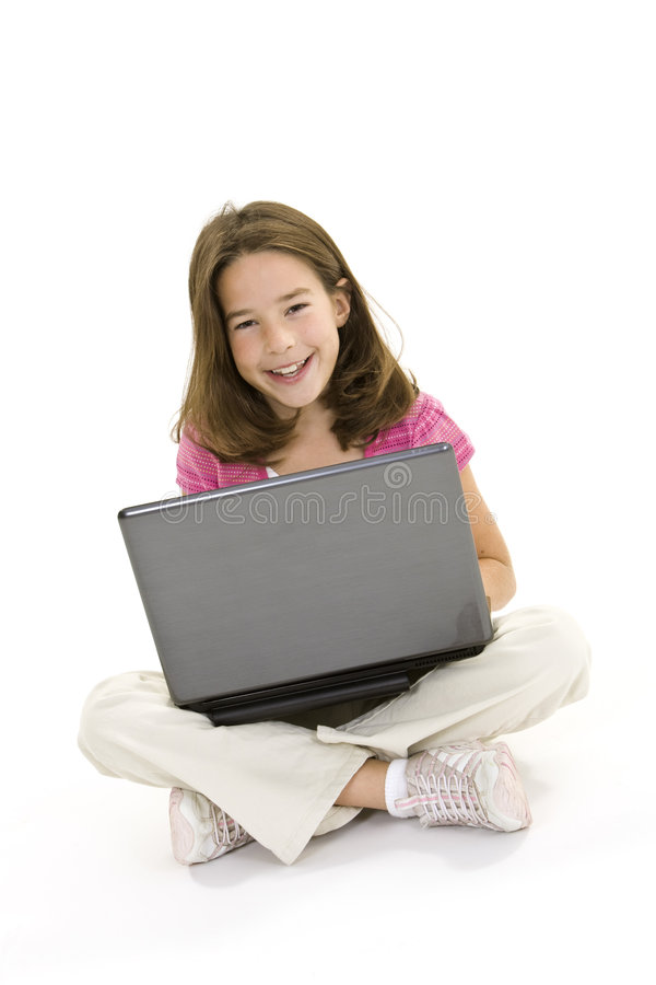 Child. Sitting on a white background with a laptop computer royalty free stock photos