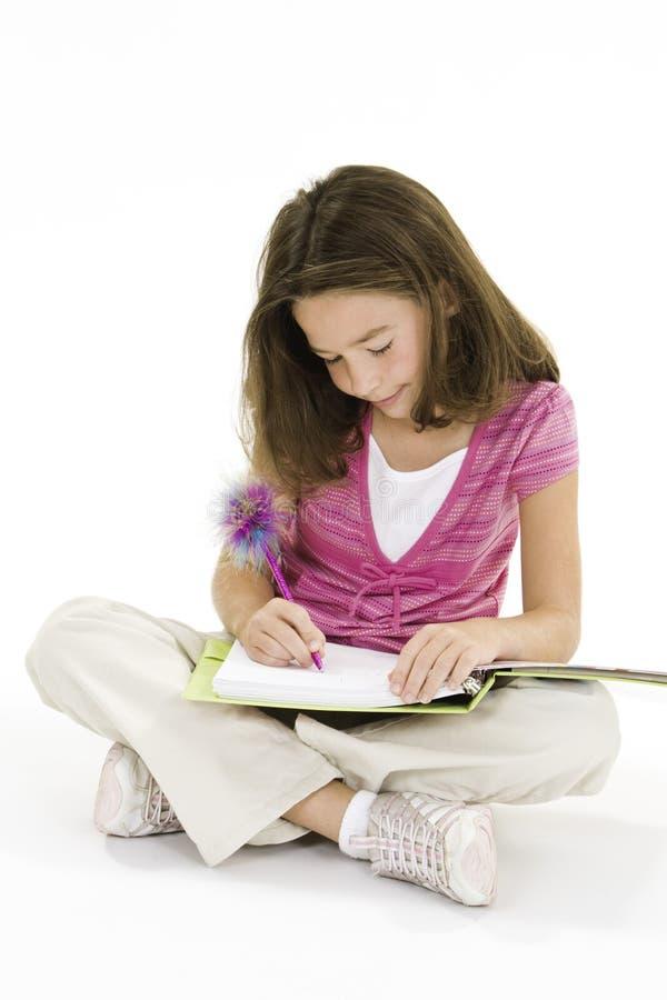 Child. Working on homework on white background stock photo