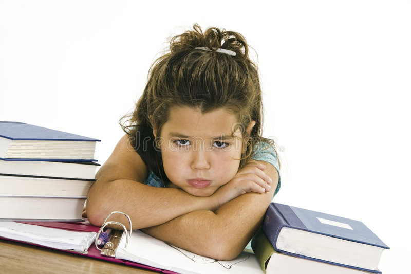 Child. Very up set while working on homework on white background stock images