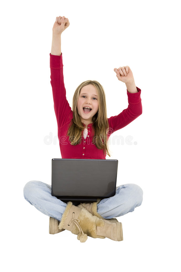 Child. Sitting on a white background with a laptop computer royalty free stock photography