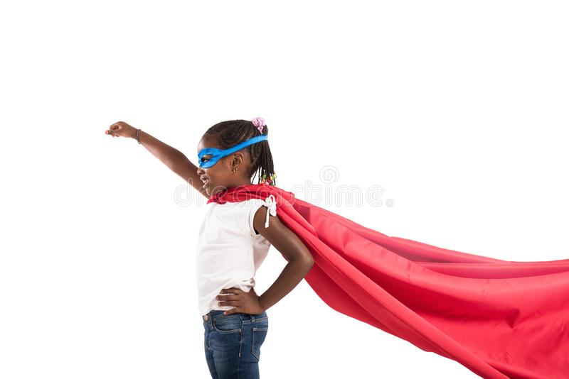 Child acts like a superhero to save the world royalty free stock photo
