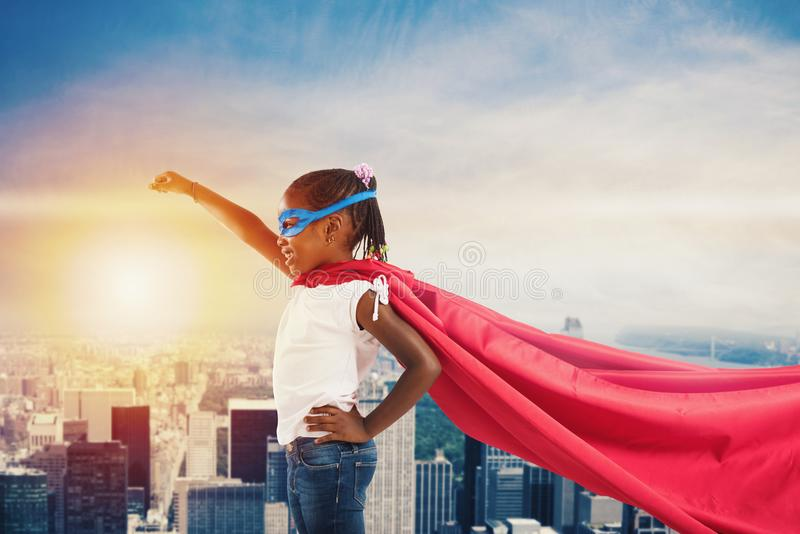 Child acts like a superhero to save the world royalty free stock images