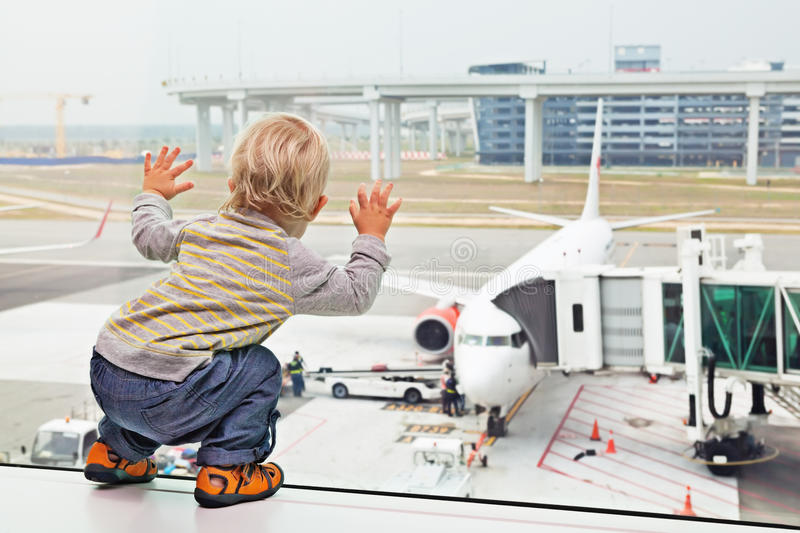 Child, airport, travel, baby, family, vacation, gate, boy, airplane, plane, aircraft, passenger, boarding, departure, summer, wait stock photos