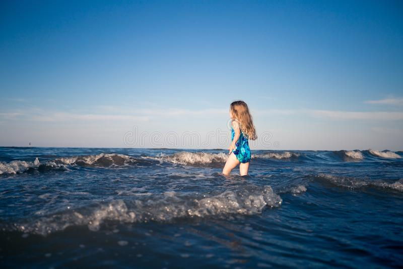 Child alone in the sea royalty free stock images