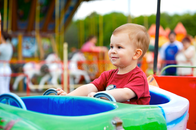 Child In Amusement Park Royalty Free Stock Images