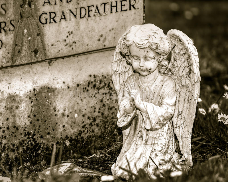 Child Angel Statue in Sepia. Shallow Depth of Field stock photography