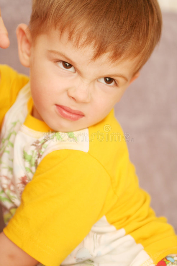 The child is angry stock photos