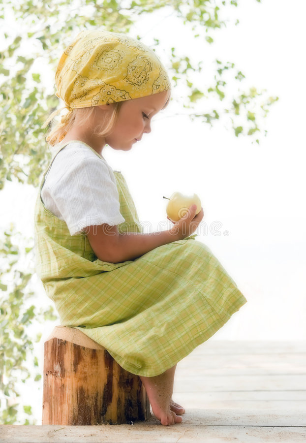 Child with apple royalty free stock photography