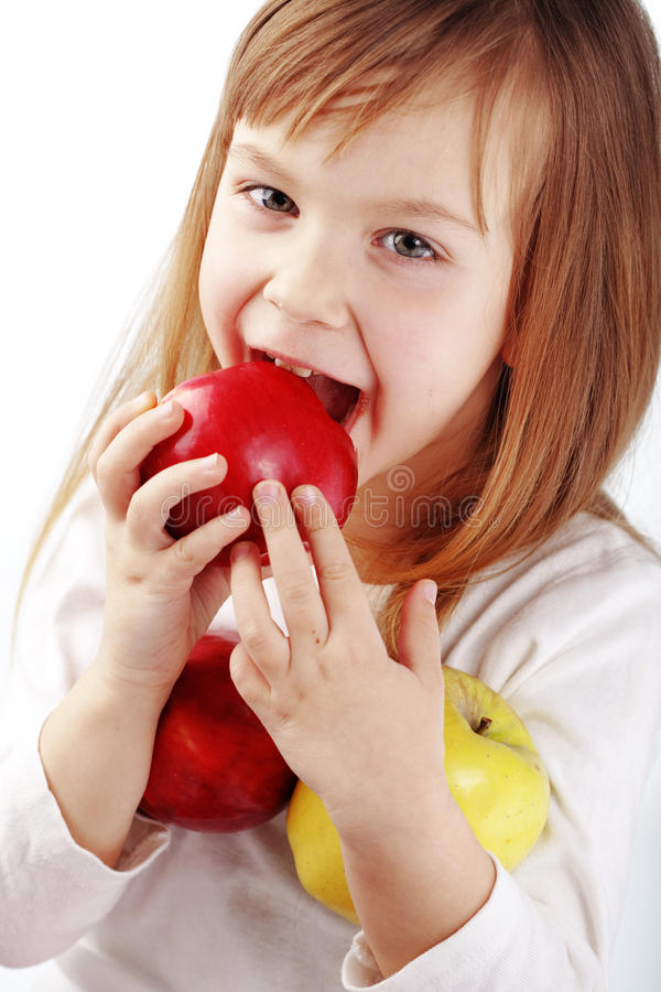 Child With Apples Stock Image