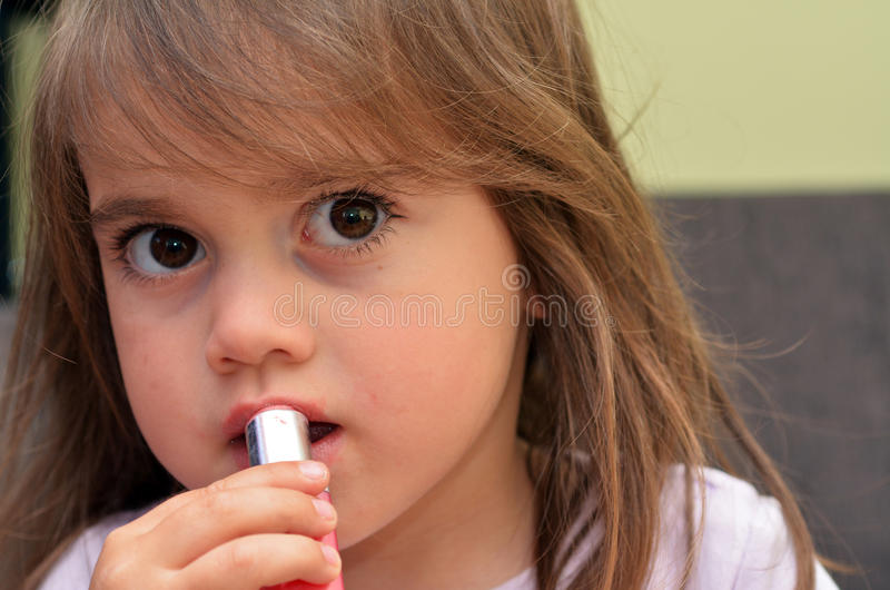 Download Child apply lipstick stock image. Image of face, childcare - 39417275