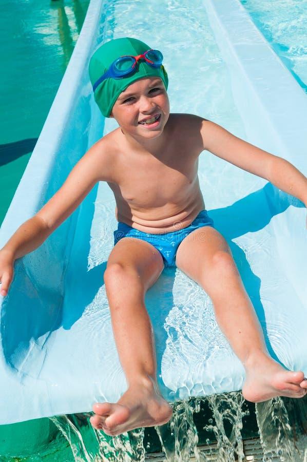 Child in aqua park stock image