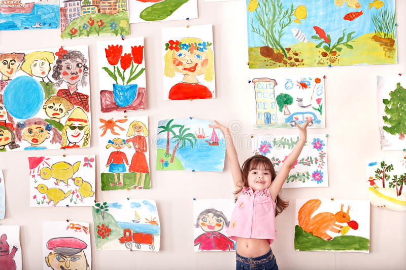 Child in art class with picture. Preschool royalty free stock photography