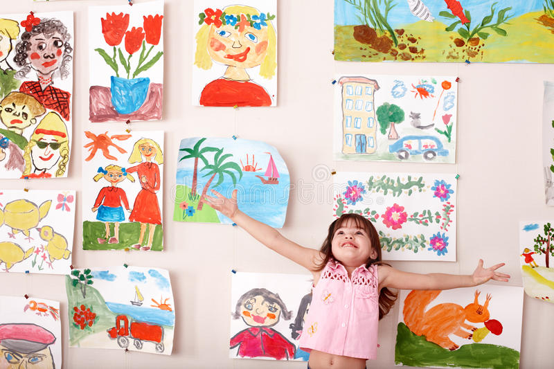 Child in art class with picture. Preschool stock image