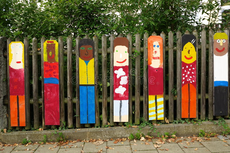 Child art displayed on wooden fence stock photography