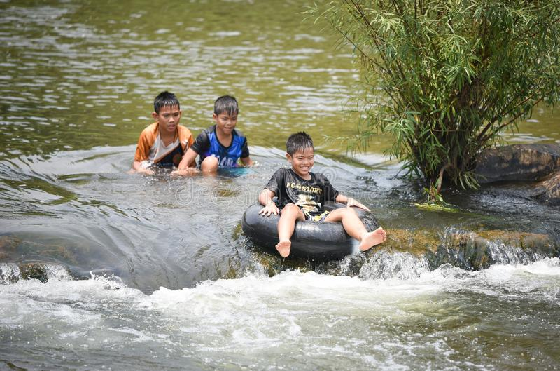 Child Asia Fun Water Rafting stock image