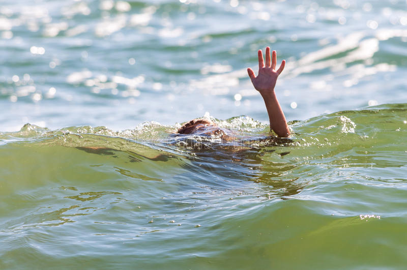 Help hand sign rescue child sinking drowning