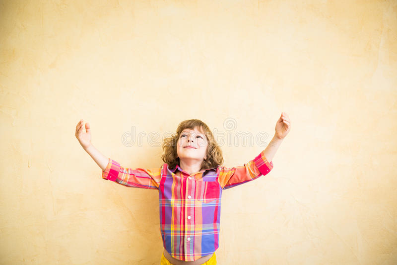 Child in autumn. Happy child playing at home. Drawing autumn theme. Imagination and freedom concept royalty free stock photography