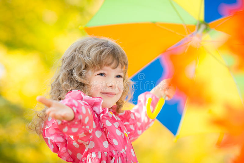 Child in autumn. Happy child playing outdoors in autumn park royalty free stock images