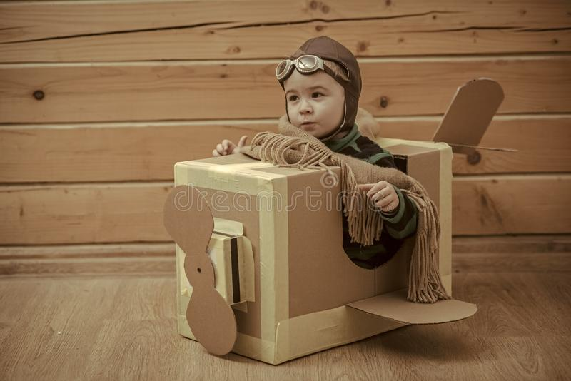Child aviator. boy pilot flying in a cardboard box. Child aviator. Young boy pilot flying in a cardboard box stock photography