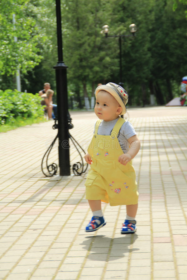 Child, baby, boy walks in the park. stock photography