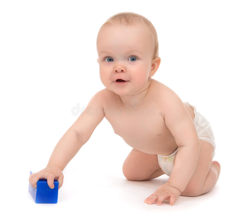 Child baby girl toddler sitting with blue toy brick. Cute child baby girl toddler sitting crawling happy smiling with blue toy brick in hand on a white stock photos