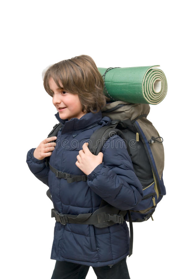 Child with a backpack ready for a trip royalty free stock photos