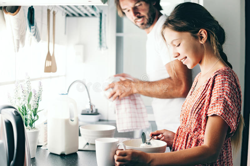 Child baking with parent stock photography