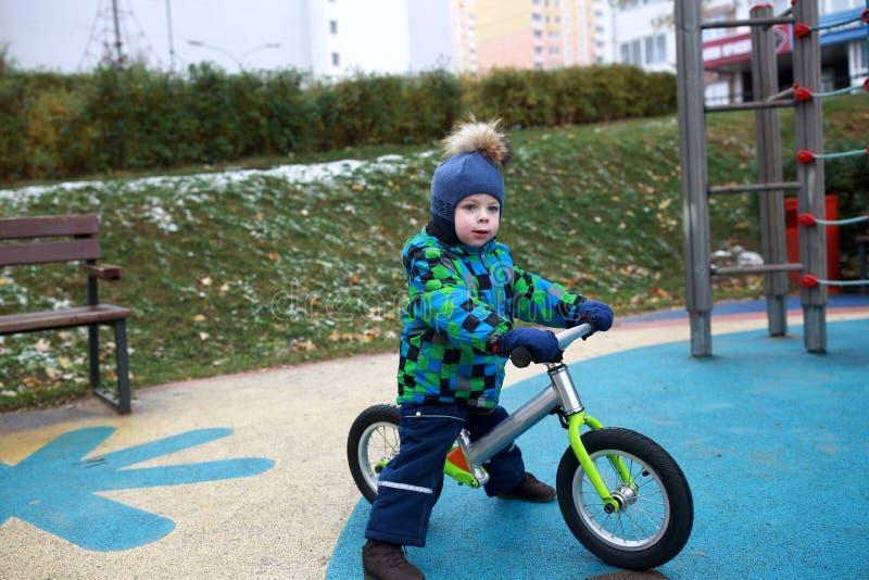 Child on balance bike royalty free stock photos