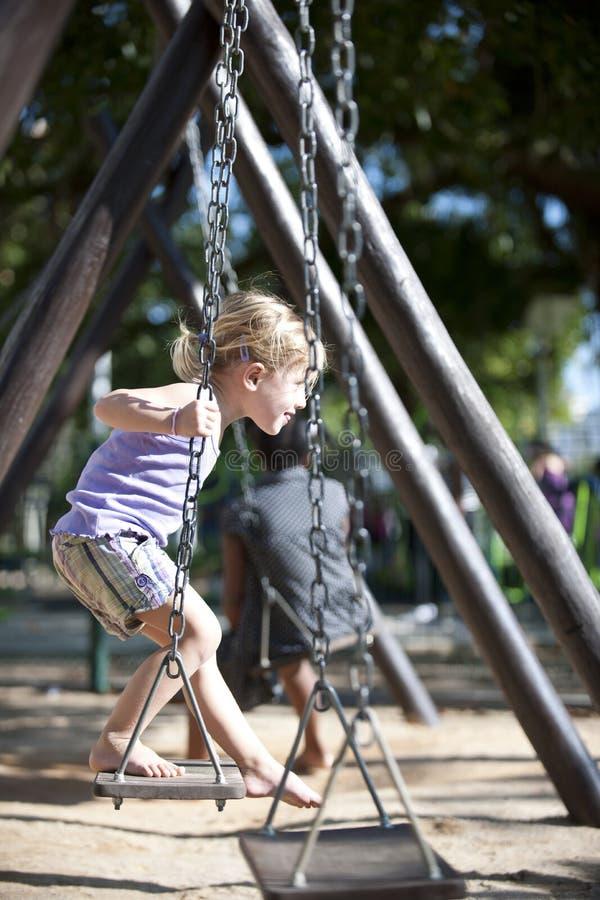 Download Child Balancing On Swing, Urban Playground Stock Photo - Image: 19201786