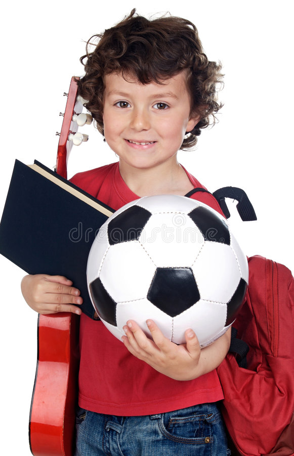 Child with ball, book and guitar royalty free stock photo