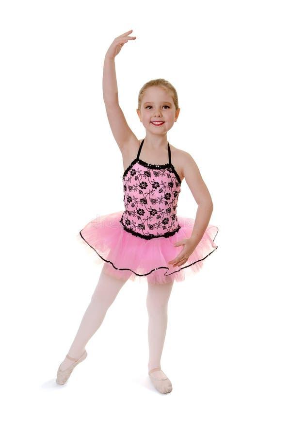 Child Ballet Dancer Does Tendu in Costume stock image
